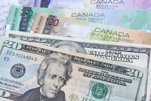 Image of Canadian and U.S. dollars to underline that a Canadian web developer like Selaris Media offers companies in the United States exceptional savings on website design, copy writing, SEO and web application development.