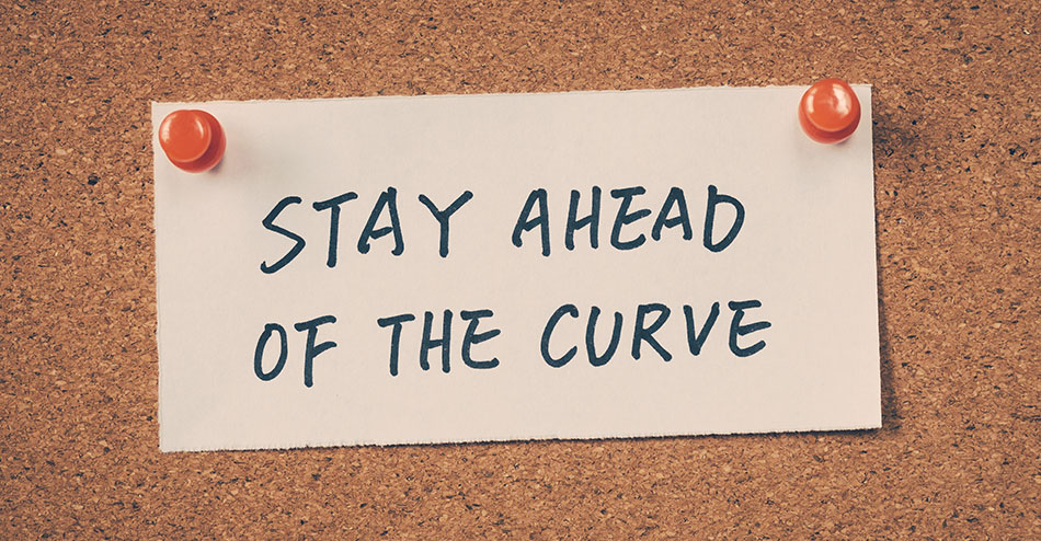 photo of a corkboard with a message to 'stay ahead of the curve', meaning you should always implement best practices for your website to maintain good page rankings and avoid penalties for black hat SEO techniques