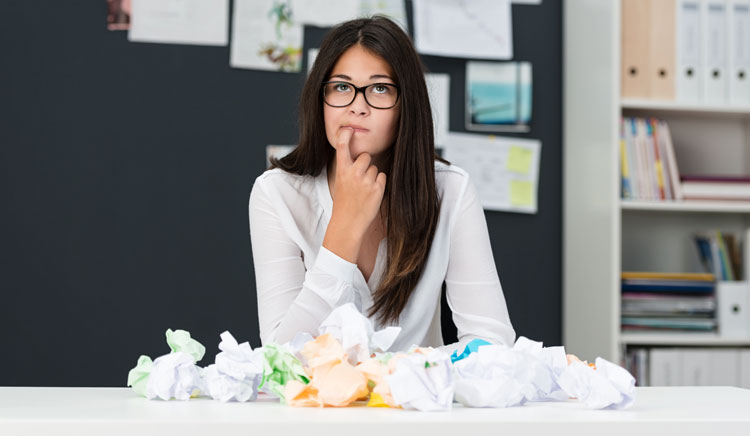 Photo of a woman with writers block, a common problem for business owners trying to find the words for their business website